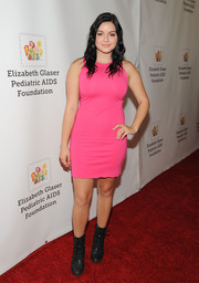 Ariel Winter kept it youthful and peppy in a hot-pink mini dress while attending A Time for Heroes Family Festival.