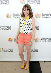 Joey King looked totally playful in this black and white heart-print button down with yellow trim.