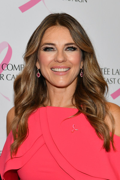 Elizabeth Hurley Dangling Gemstone Earrings [hair,beauty,pink,human hair color,blond,hairstyle,eyebrow,fashion model,shoulder,long hair,estee lauder,elizabeth hurley,est\u00e3,new york city,bar sixtyfive,breast cancer campaign]