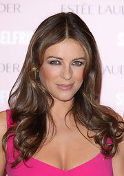 Elizabeth Hurley complemented her hot pink dress with a softer pink lipstick at the Estee Lauder Companies' Breast Cancer Awareness event. To recreate Elizabeth's look, we recommend a sheer, moisturizing formulation with lots of shine.