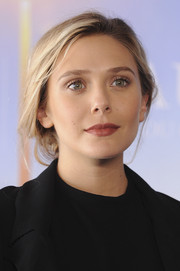 Elizabeth Olsen attended a Deauville American Film Festival photocall wearing her hair in a casual updo.