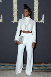Janelle Monae flaunted her killer abs in a cropped white moto jacket at the Elle anniversary celebration.