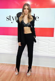 Abbey Lee was sexy-edgy in a black pantsuit teamed with a leather bra while visiting Amazon's 'Style Code Live.'
