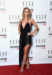 Rosie Huntington-Whiteley must have had all eyes on her when she attended the Elle Style Awards wearing this jawdroppingly sexy Anthony Vaccarello halter dress that showcased both cleavage and legs.