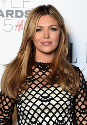 Abbey Clancy opted for a casual yet chic center-parted 'do when she attended the Elle Style Awards.