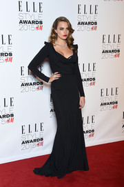 Cara Delevingne arrived at the 2015 Elle Style Awards in a sultry black gown with long sleeves.