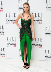 Taylor Swift's green and black Julien Macdonald dress at the Elle Style Awards had a bondage-glam feel with its strappy shoulders and zip-up front.