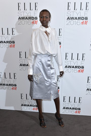 Alek Wek chose a silver satin skirt to pair with her blouse.