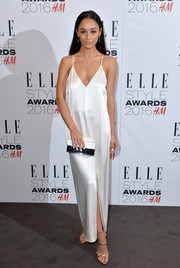 Cara Santana polished off her ensemble with an elegant two-tone box clutch.