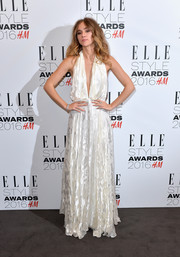 Suki Waterhouse looked alluring in a plunging white burnout halter gown by Camilla and Marc at the Elle Style Awards.