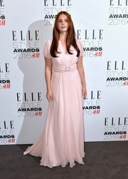 Lana Del Rey made a demure choice with this short-sleeve pink gown for her Elle Style Awards look.