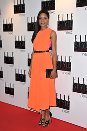 Naomie Harris rocked vibrant colors on the red carpet in this orange and neon orange and hot pink tea-length dress.