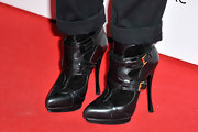 Juno Temple's rocker edge came out with these leather buckle ankle boots at the Elle Style Awards in London.