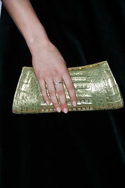 Samantha Barks added some fun color to her evening look with a light green, pearlized clutch.