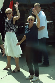 Portia de Rossi chose a black and white floral blouse for a fun and flirty look while greeting fans in Australia.
