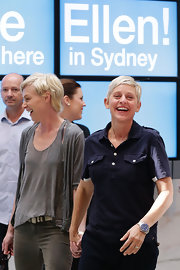 Ellen DeGeneres chose a navy polo with front, breast pockets for her preppy look while arriving in Sydney.