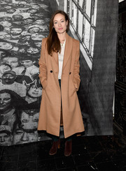 Olivia Wilde bundled up in a beige wool coat for the New York premiere of 'Ellis.'