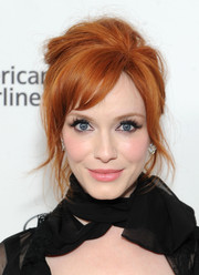 Christina Hendricks channeled Brigitte Bardot with this messy-sexy beehive during the Elton John AIDS Foundation Oscar viewing party.
