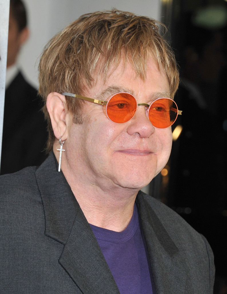 6692339f78 Elton John opted for his signature round shades for an appearance at  Project Angel Food s event