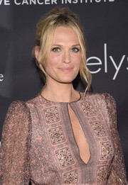 Molly Sims attended the Pink Party wearing her locks up in a messy-romantic 'do.