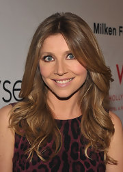At the Elyse Walker Pink Party, Sarah Chalke wore her tresses in lovely, cascading waves. Her look can be recreated by curling two-inch sections of hair with a large-barreled curling iron and lightly tousling with fingers.