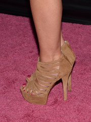 A.J. Cook attended the Pink Party wearing a pair of ultra-high beige strappy sandals.