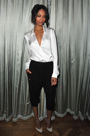 Zoe wore a buttonless crisp white blouse with sparkling harem pants for the Michael Kirs dinner in Paris.