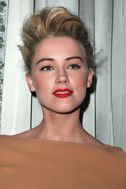 Amber Heard added a sultry touch to her look with a matte crimson pout. This sexy look screams sexy glamour!