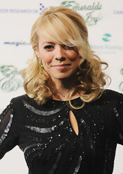 Liz Mcclarnon fixed her blonde curls in a romantic half-up half-down style for the Emeralds and Ivy Ball.
