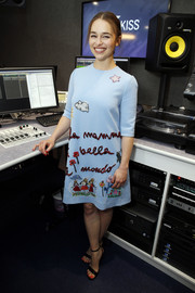 Emilia Clarke looked absolutely adorable in a pastel-blue Dolce & Gabbana dress adorned with quirky embroidery.