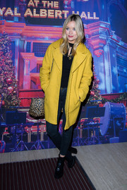 Laura Whitmore teamed her coat with cropped skinny jeans and a black top.