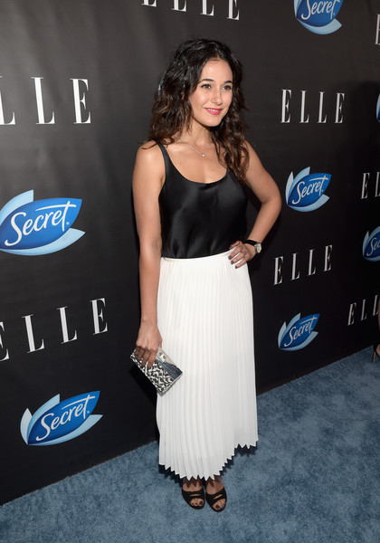 Emmanuelle Chriqui Printed Clutch [cover,clothing,dress,shoulder,cobalt blue,electric blue,fashion,carpet,cocktail dress,premiere,long hair,red carpet,leslie jones,kate mckinnon,emmanuelle chriqui,melissa mccarthy,stars,kristen wiig,elle hosts women in comedy event,event]