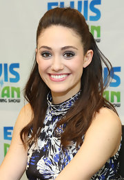 Emmy Rossum sported a half-up-half-down 'do featuring a high crown and loose wavy ends.