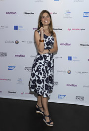 Sarah Wiener headed out for an evening at Emotion Award 2012 wearing a casual pair of navy wedge sandals.