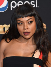 Taraji P. Henson coated her lips a vampy dark red.