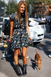 Anna dello Russo contrasted her girly dress with tough-looking studded black boots by Saint Laurent.