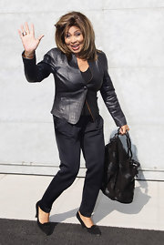 Tina Turner was as fierce as ever in a black croc-embossed leather jacket.