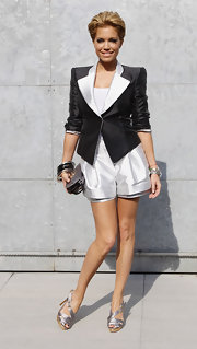 Sylvie van der Vaart donned a high-fashion white romper under her matching blazer.