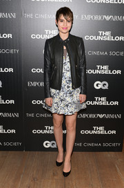 Sami Gayle added a rocker edge to her floral dress with a black leather jacket during the screening of 'The Counselor.'