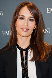 Dolores Chaplin wore her shiny tresses long and straight with lengthy side-swept bangs at the Emporio Armani store opening in Paris.