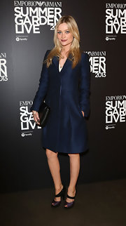 Laura Whitmore chose a deep navy coat for a more sharp and sophisticated look at the Emporio Armani Summer Garden party.