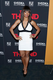 Monique Coleman wore a fitted white bandage dress with black trim and a beaded black belt.