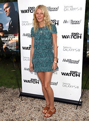 Keeping it beach-appropriate, Gwyneth Paltrow finished off her summery dress with tan leather sandals.