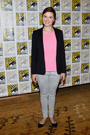 A classic blazer dressed up Veronica's pink blouse and acid-washed jeans.