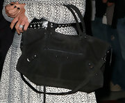 Kris Jenner completed her black and white dress with a coveted City bag in a suede texture.