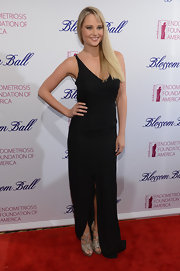 Genevieve Morton kept her look super simple with this black floor-length gown with front slit.