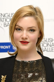 Holliday Grainger had her tresses tied in a loose ponytail for the ballet Christmas party.