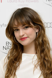 Lily James channeled rocker attitude with her hair kinked into messy waves.