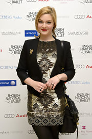 Holliday Grainger combined smart and chic by wearing a black blazer on top of her print dress.