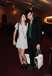 Up-and-coming British actor Douglas Booth chose gray wingtip oxfords for a night out at the English National ballet. What's in the bag Douglas? More fetching footwear?